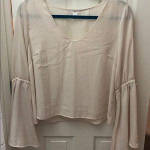 Cream blouse with bell sleeves